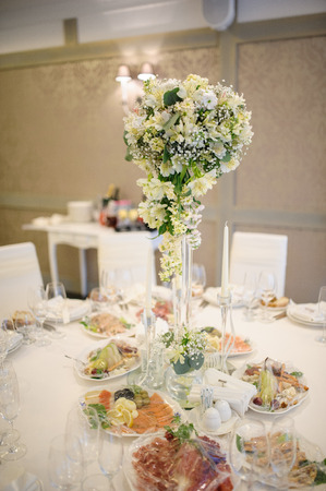 arranging chairs: Banquet wedding table setting on evening reception