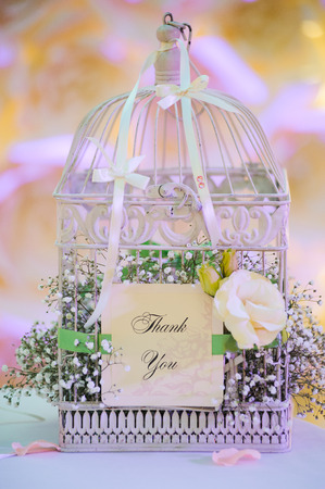 wedding decor birdcage at restaurant with all beauty and flowers Stock Photo