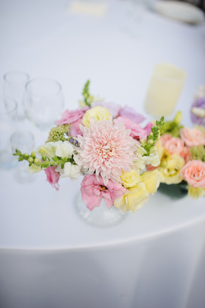 arranging chairs: wedding decor at restaurant with all beauty and flowers Stock Photo