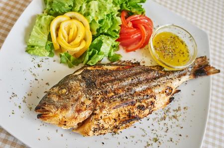 pinto bean: fried baked fish Stock Photo