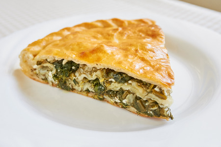 filo: Spinach and feta pie in filo pastry, with salad. Traditional Greek spanakopita.