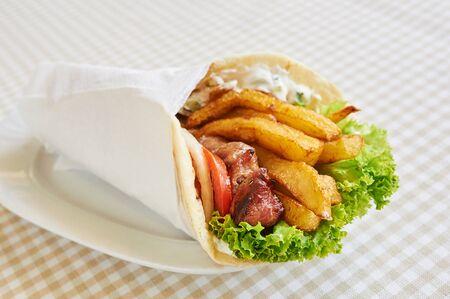 spanish onion: chicken or pork wrap sandwich
