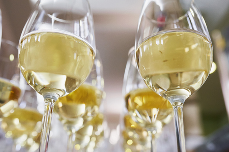white table: glasses with Champagne on white table