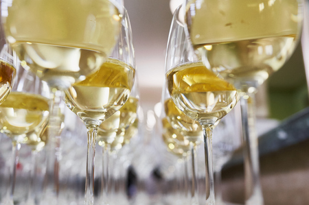 glasses with Champagne on white table