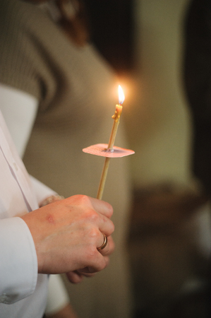 Candles during orthodox christening baptism