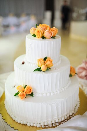 cater: wedding cake decorated with roses