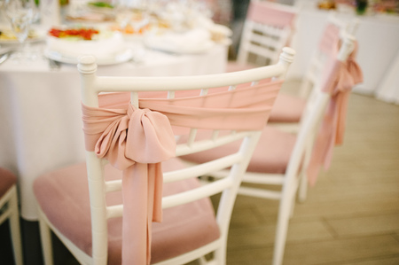 wedding chairs: Banquet wedding chairs setting on evening reception awaiting guests Stock Photo