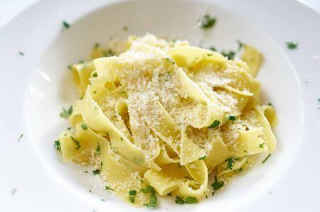 alfredo: Fettucine Alfredo pasta parmesan cheese on white plate