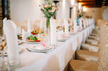 Banquet wedding table setting on evening reception awaiting guests