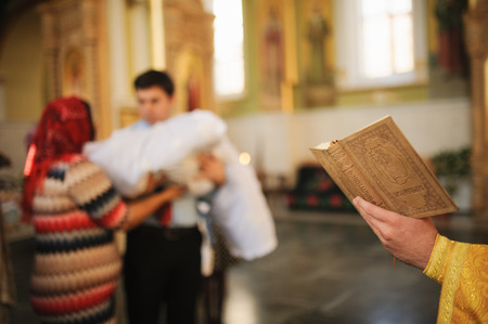 credo: Holy orthodox book during christening baptism
