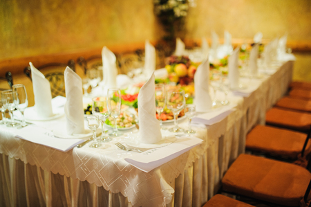 awaiting: Banquet wedding table setting on evening reception awaiting guests
