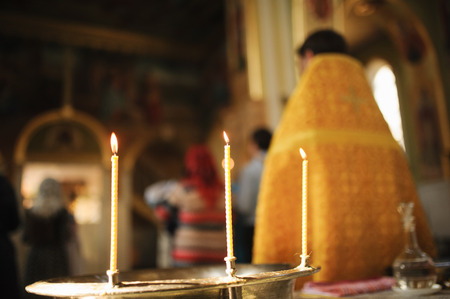 Three Candles during orthodox christening baptism