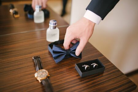 cuff link: Groom is preparing for his wedding at morning Stock Photo