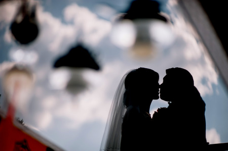 wedding dress silhouette: Bride and groom kissing silhouette on their wedding
