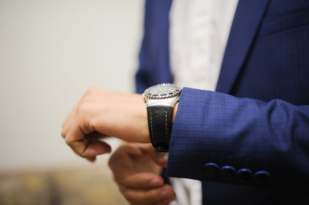 cuff link: a groom is Getting Ready and showing watches