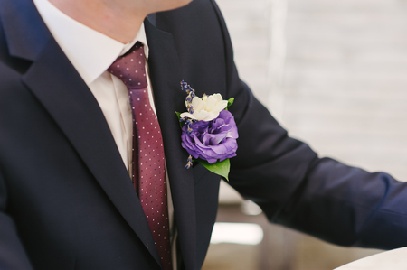 pinning: Pinning a Boutonniere for groom on wedding day