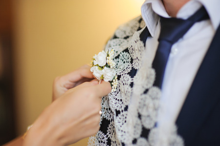 handcarves: Pinning a Boutonniere for groom on wedding day