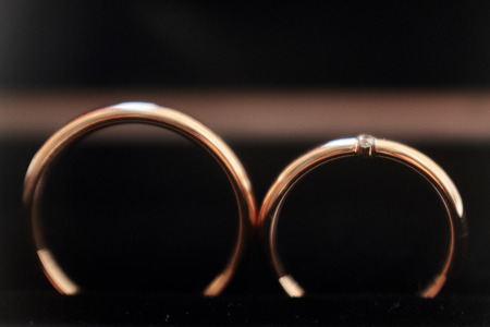 Wedding rings on black background. Macro shot