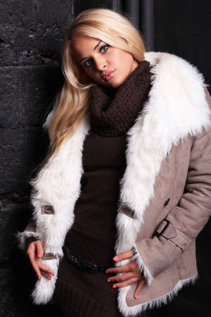 Beautiful blond woman in a fur photo
