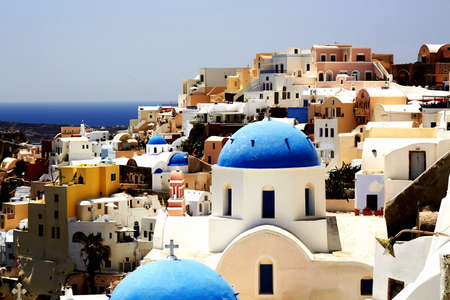 Blue and white churches of Santorini, Greece photo