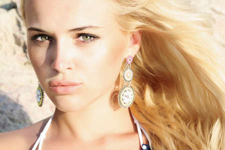 fashion jewellery: Beautiful mysterious blond woman  stone background Stock Photo