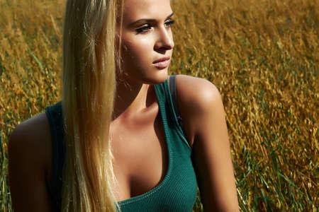 Beautiful blond woman on the field photo