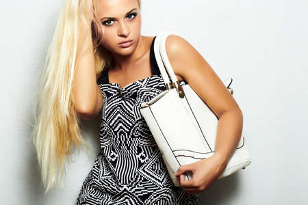 beautiful blond woman with handbag. shopping.beauty girl.long hair