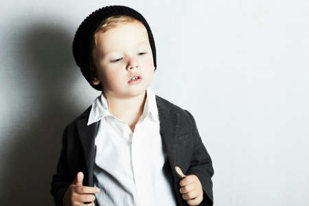 fashionable little boy in cap.stylish kid. fashion children