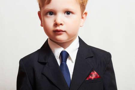 fashionable little boy in suite. business kid. fashion children. blue tie. manager Banque d'images