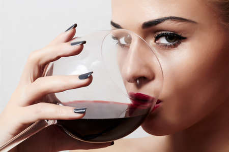 girl drinking: Beautiful blond woman drinking red wine