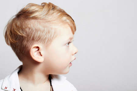 little boy with stylish haircut