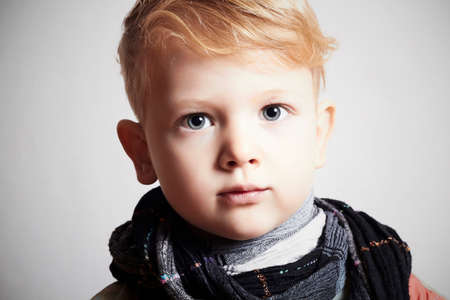 fashionable handsome little boy in scarf photo
