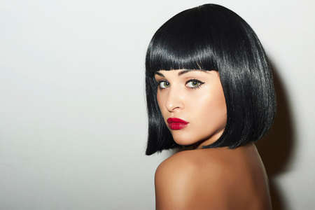 Beautiful Brunette Girl. Healthy Black Hair. bob Haircut. Red Lips. Beauty Woman