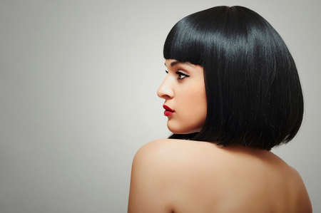 Beautiful Brunette Girl. Healthy Black Hair. bob Haircut. red lips. beauty woman