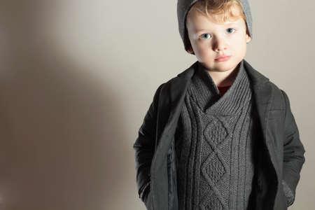 blue grey coat: Fashionable Little Boy in Hat.Winter child