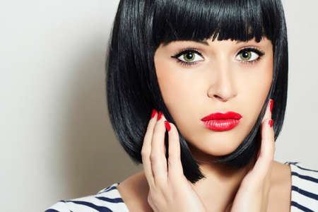 Beautiful Brunette young woman.Bob haircut