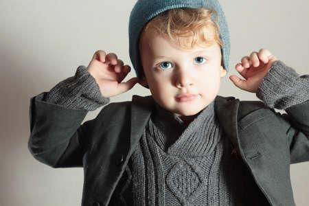 stylish boy: Fashionable Little Boy in Cap.Stylish Kid.Fashion Children.Handsome blond kid.Winter