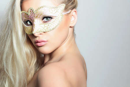 Beautiful Blond Woman in Carnival Mask.Masquerade. Sexy Girl. Lovely Lady
