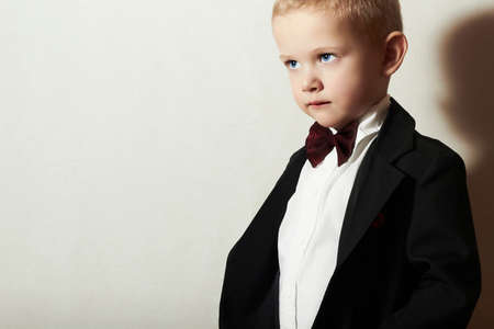 Fashionable Little Boy in Bow tie.Stylish kid. fashion children. 4 Years Old Child in Black Suit Banco de Imagens