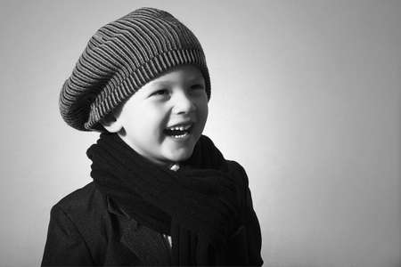 Laughing Little Boy in Cap. Style Kid. Fashion Children. Handsome Child in Scurf. Smiling kid. Winter wear