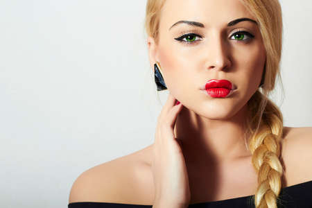 Beautiful Blond Woman with Tress.Beauty Red Sexy Lips.Valentines Day.Professional Make-up. Freak Girl with Heart on the Lips Stock Photo
