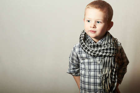 school age boy: Child. funny little boy in scarf. Fashion Children. 4 years old. plaid shirt
