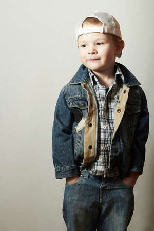 4 years old: Posing Child. Funny Little Boy in Jeans. Trucker cap. joy. Fashionable Kid 4 years old Stock Photo