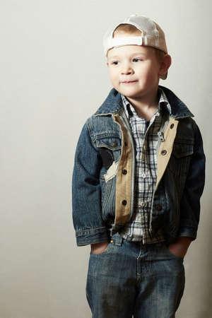 trucker: Posing Child. Funny Little Boy in Jeans. Trucker cap. joy. Fashionable Kid 4 years old Stock Photo