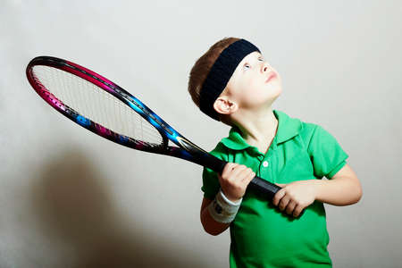 Boy.Little Sportsman Playing Tennis. Sport Children. Child with Tennis Racket