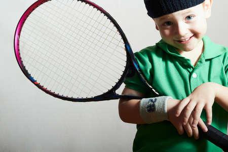 Smiling Little Boy Playing Tennis. Sport Children. Child with Tennis Racket