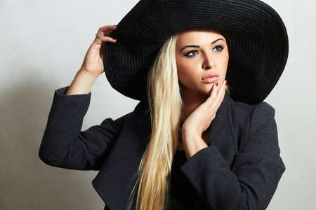 topcoat: Beautiful Blond Woman in Black Hat. Fashionable Lady in Topcoat Stock Photo