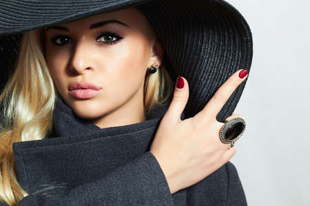 topcoat: Beautiful Blond Woman in Hat. Fashionable Lady in Topcoat. Elegance Beauty Girl Stock Photo