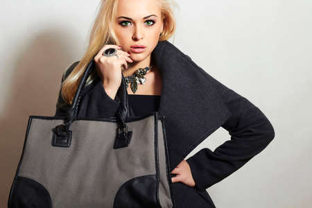 topcoat: Beautiful Blond Woman in Topcoat. Fashionable Lady.Beauty Girl with Handbag. Shopping