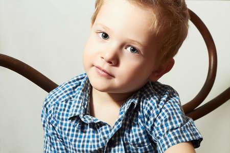 Child. Handsome little boy.Fashion Children.Emotion.Vintage furniture